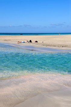 Swimming in between yoga classes at Elafonisi Beach, Chania, Crete