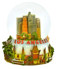 Los Angeles snowglobe.  Filled with city skyscrapers, Grauman's Chinese Theatre, the Getty Museum tram.  Rodeo Drive and lots of lovely palm trees all around the base.  Music box plays California Dreamin'.  Shakes lots of translucent glitter.
