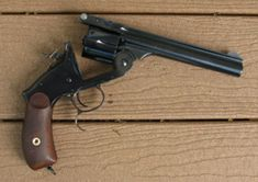 Smith  Wesson top break revolver, a gun whose barrel tipped down and simultaneously ejected all empty shells and could be reloaded quickly. The #3 American model in a .44 caliber was in fact adopted by the U.S. Army in 1870 as their first center fire revolver, and as might be expected was preferred by many Army officers and men to the cap and ball Colt 1860 Model for speed in loading