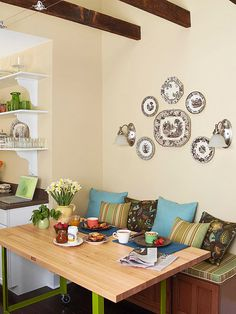 Symmetrical Arrangement  Create a picture-perfect plate arrangement on your walls with a little bit of prep work. Trace the items you plan to hang onto paper. Cut out the shapes and tape to the wall in different arrangements until you get the perfect combination.  LOVE this next to the kitchen!
