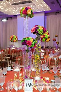 Wedding centerpiece idea designed with glass fusion and fresh floral bouquets. #glassfusion #flowers #tablecenterpeiceideas #reception #weddings
