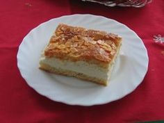 <b>German Bienenstich</b>: Bienenstich or <q>Bee sting cake</q> is a Bavarian dessert made of a sweet bread (with or without yeast) with a baked-on topping of honeyed almonds and filled with a vanilla custard.
