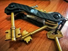 A wonderful keys setup by our customer using his AmazinGizmo key organizer to manage his large vintage keys. Wonderful setup proving this key holder is capable of integrating various, even most unusual keys in a reliable way Stainless Steel Bolts, Key Organizer, Smart Key, Vintage Keys, Compact, Organization, Getting Organized, Organisation, Tejidos