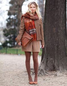 Earthy colors, monochromatic outfit: plaid scarf, brown jacket, brown mini skirt, opaque brown tights and brown accessories.