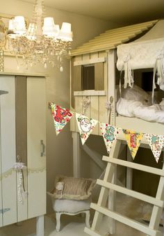 Adorable kid's room... Loft beds, fort design.