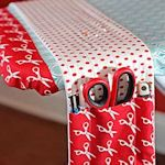 (Jenni) An organizer for your Ironing Board! Genius! #SewingRoom #CraftRoom #GoodIdea