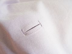 Tutorial for making bound buttonholes on a garment. Will work for the crossover blazer pattern I just purchased from Burda.