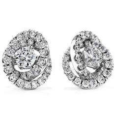 A sparkling knot of Hearts On Fire diamonds surrounds the Hearts On Fire center diamond to create a knockout pair of diamond stud earrings that are bound to melt your heart.  Starting at $9,800 Starting Total Carat Weight: 1.60