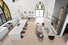 church turned into a home in Chicago! Modern home. Modern living room. Fireplace. A room with a view!