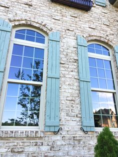 Make your exterior details exquisite with the right choice of brick, mortar and trim color. Rustic Brick House Exterior, Shutters Brick House, Stone Exterior Houses, Blue Shutters, Exterior Trim, House Paint Exterior, Exterior Paint Colors, House Exteriors, Brick Building