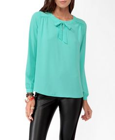 This color is great. I wear it with jeans and boots or black stretch pants with boots and a sweater.