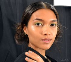 Backstage Beauty: The Prettiest Makeup of Spring 2014 - At Lela Rose, Stila makeup artist Romy Soleimani swiped a pop of lime green shadow on the lids, keeping the rest of the look pared down with just a subtle pop of pink on the lips. #niciasonoki #primp