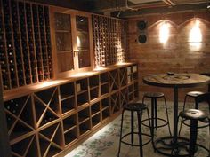 Wine Cellar This solid oak wine storage unit, with racks for single bottles and sliding shelves below for cases of wine, was made for the basement of a town house in west London.