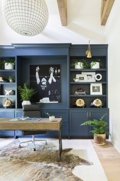 Home Reveal. Hilltop Home Reveal office built-ins in Gale Force by Sherwin Williams Navy built-ins hide rug brass sconces large capiz shell chandelier Home Office Space, Home Office Design, Home Office Decor, Home Decor, Office Ideas, Office Rug, Office Designs, Office Table, Navy Office