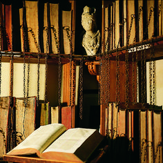 Wimborne Minister Chained Library, Dorset, England - Located in the parish church of Wimborne is one of the UK's first public libraries. The room of its massive tomes linked to the shelves is now run by volunteers, and still open to the public.
