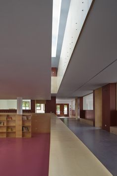 Interior shot of a primary school featuring a colourful facade with contrasting window details.