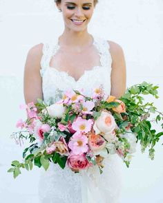 Pretty in Pink Wedding Bouquet Ideas | Martha Stewart Weddings - Sarah Winward of Honey of a Thousand Flowers created this overflowing bouquet of peonies, garden roses, dahlias, jasmine vine, and ranunculus.