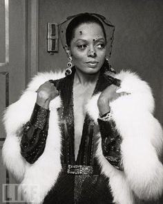 diana ross in furs and a veil and jewels and sequins!