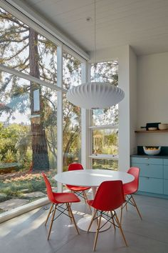 This small dining area that has been set up with a mid-century modern look..