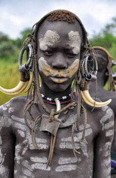 Africa   Mursi boy. South Omo Valley, Ethiopia   ©Rod Waddington.