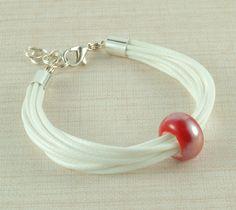 #bransoletka z ceramicznym koralikiem na DaWanda.com Headphones, Earrings, Etsy, Ear Rings, Headpieces, Stud Earrings, Ear Phones, Ear Piercings, Ear Jewelry