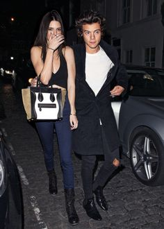 Kendall Jenner and Harry Styles>> HIS ARM IS AROUND HER I REPEAT HIS ARM IS AROUND HER