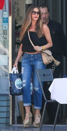 Ready for the weekend: Sofia Vergara picked up some food to go on Friday in a pair of giant gold wedge platform sandals