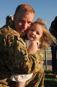 Colorado National Guard Chief Warrant Officer 2 Aaron Peterson hugs his daughter, Evie, upon his return home from Afghanistan at Buckley Air Force Base. Welcome home CW2 Peterson and the rest of the 135th General Support Aviation #Soldiers!