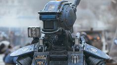 """What if a robot had the ability to think and feel? That question is tackled in the film """"Chappie,"""" starring Hugh Jackman and Dev Patel, and directed by """"District auteur Neill Blomkamp. Sharlto Copley, Neill Blomkamp, Unfinished Business, 2015 Movies, Columbia Pictures, Movie Wallpapers, New Trailers, Hugh Jackman, Feature Film"""