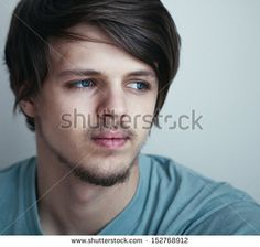portrait of a little sad young man with beautiful eyes - stock photo