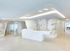 Raiffeisen Bank portraits milled into wall panels