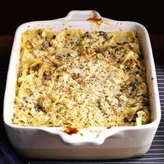 Artichoke Spinach Lasagna Recipe -Friends of ours served this homey dish when we visited them in Maryland. We just had to get the recipe and have since added a few items to make it even tastier. —Carole Rago, Altoona, PA