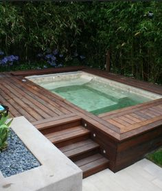 """Contemporary Hot Tub with Epoch - Jura 1"""" x 1"""" Limestone Mosaic Tile in Beige, Pathway, Fence"""