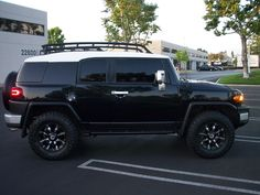 Black Toyota FJ-Cruiser with RBP 94R Gloss Black with Chrome Inserts Wheels.