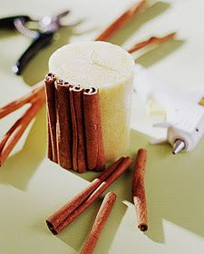 cinnamon sicks glued around a candle.