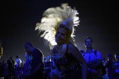 A woman swings her hair while dancing to the legendary four-piece, which became on Friday the most famous act to play in Cuba since its revolution in 1959
