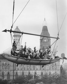 Schoolchildren from Camberwell enjoying themselves on a fairground ride as part of a coronation treat laid on by the borough council One of the towers of the Old Crystal Palace can be seen in the background, 20th May 1937.