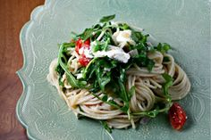 I LOVE arugula!!! This is pasta with lemon, arugula and tomatoes. A little ricotta on top...yummy next to a filet of grilled halibut! Sounds like dinner tonight! :) But i have some lemon pepper pappardelle I need to use...YUM!!