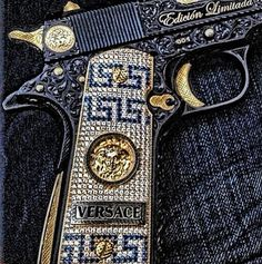 Versace If you can't shoot for shit, you can always Bedazzle your pistol!