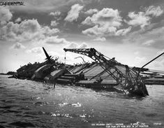 """""""Salvage operations, USS Oklahoma sunk during the Pearl Harbor attack. View aft of the ship at the position. Pearl Harbor 1941, Pearl Harbor Attack, Uss Oklahoma, Remember Pearl Harbor, Uss Arizona Memorial, Capital Ship, Us Navy Ships, Abandoned Ships, Naval History"""