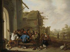 Cornelis Saftleven | Figures before a Village Inn, Cornelis Saftleven, 1642 | Boerengezelschap. Vrolijk gezelschap met een groep mannen die kaartspelen aan een tafel op een terras voor een herberg. Tussen de mannen ook een monnik en een vioolspeler. Op de grond liggen kruiken, een vuurtestje, kaarsen, een kat en een hond met jongen. Rechts een boerenschuur met duiven, een paard met wagen en andere huizen van het dorp.