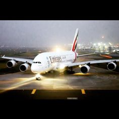 Night Flight - Emirates Airbus A-380 taxiing to the runway of Mumbai's Chhatrapati Shivaji International Airport
