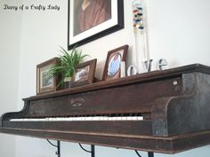 Upcycled upright. This shelf was made from a real piano - this keyboard section was cut off and mounted on the wall!