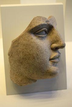 An Exceptional Tarentine (Greek) Terracotta Fragment of a Female Head 440-430 BCE,Taras,Calabria Getty Villa