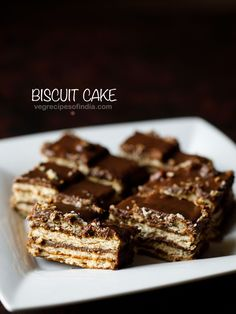 biscuit cake recipe with step by step pics. biscuit cake is one of the easiest and yummy cake recipe one can make. this no bake biscuit cake has chocolate in it and tastes too good.