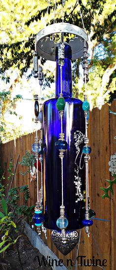 This is an original, one-of-a-kind wind chime. Made from a recycled blue vodka bottle Tom has added a metal bracelet to the top and with a mixture of beads, baubles and charms hanging down it creates a lovey sound for any backyard or patio. Thank you for stopping by our shop! Tom and Diane