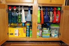Use a tension shower rod under the sink to hang spray bottles.