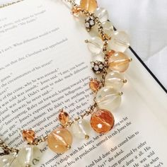 j crew bauble necklace Make a statement! Big bauble necklace from J Crew. Antiqued gold chain, translucent white and peach toned balls and little rhinestone balls. Hits in center of chest. Great condition! J. Crew Jewelry Necklaces
