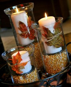 Corn in glasvases with candles. Decor with leafs.. looks so cute