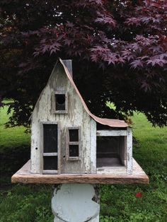 Birdhouse complete with a screened in porch :)